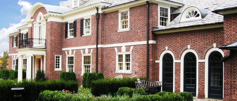 Brick home with custom arched top doors and porch columns